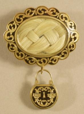Broche de ouro e esmalte, com o cabelo entrançado envolto em vidro, 1848.